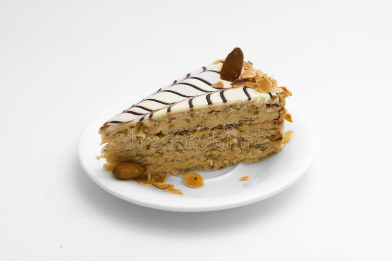 Slice of Sweet cake with nuts stock images