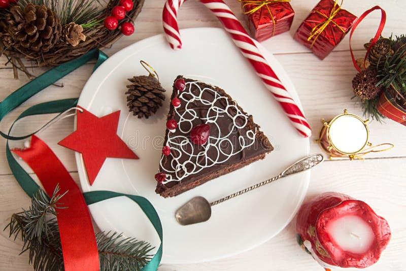 Slice of sweet chocolate cake for Christmas Eve. royalty free stock image