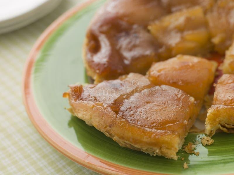 Slice of Tarte Tatin aux Pomme stock photos