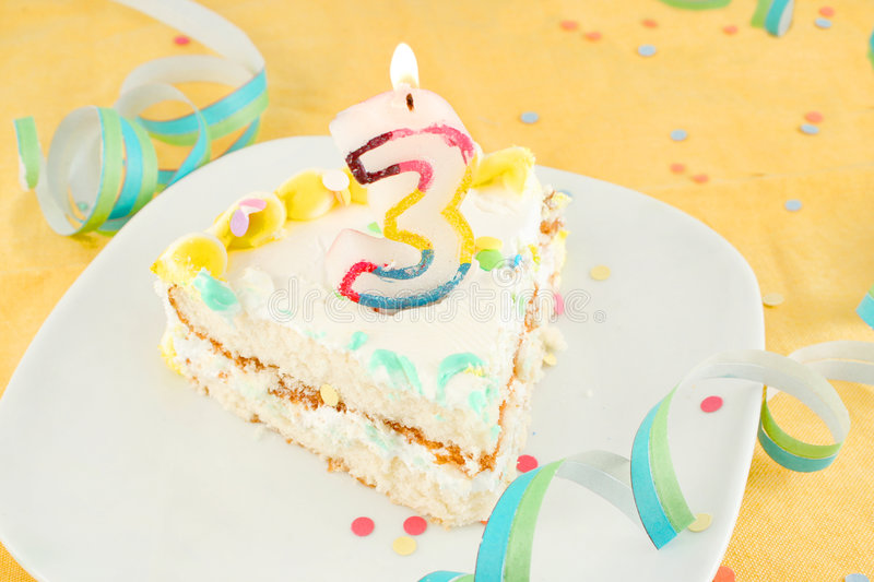 Slice of third birthday cake stock photos