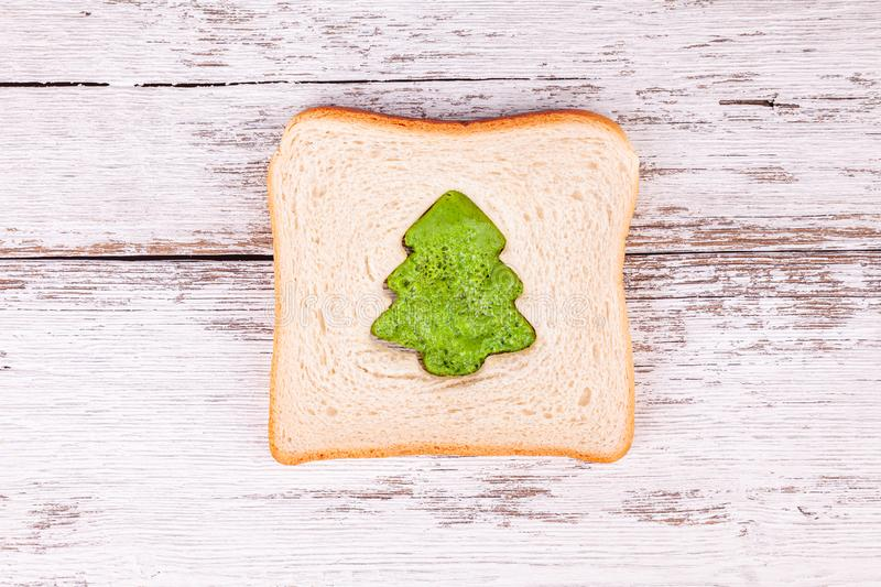 Slice of toast bread with a green omelette shaped like fir-tree, Christmas meal royalty free stock photos