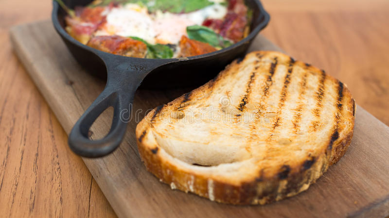Slice of toast on a wooden plank stock images