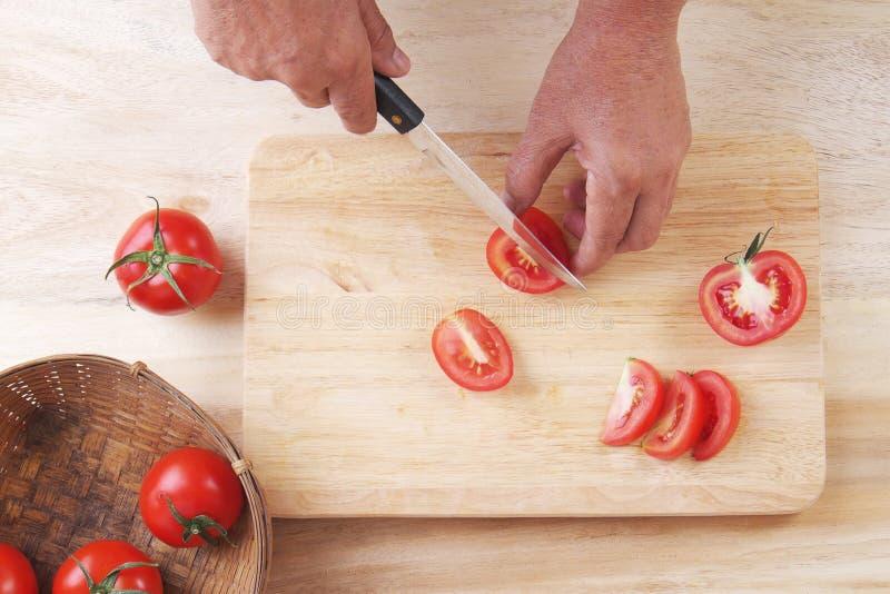 Slice Tomatoes in Half, Prepare tomato for cooking stock photos
