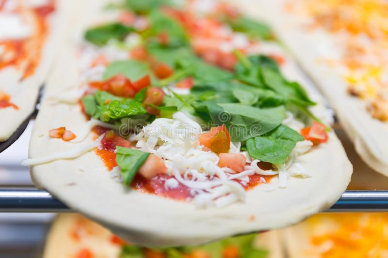 Slice of Uncooked pizza royalty free stock photography