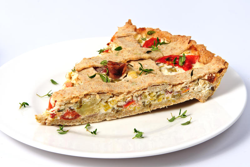 A slice of vegetable tart stock image