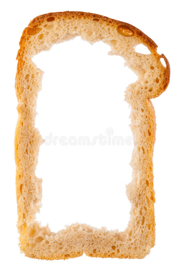 Slice of white bread with center missing, crust as frame royalty free stock images