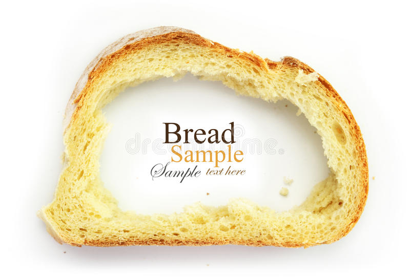 Slice of white bread with center missing, crust as stock photography