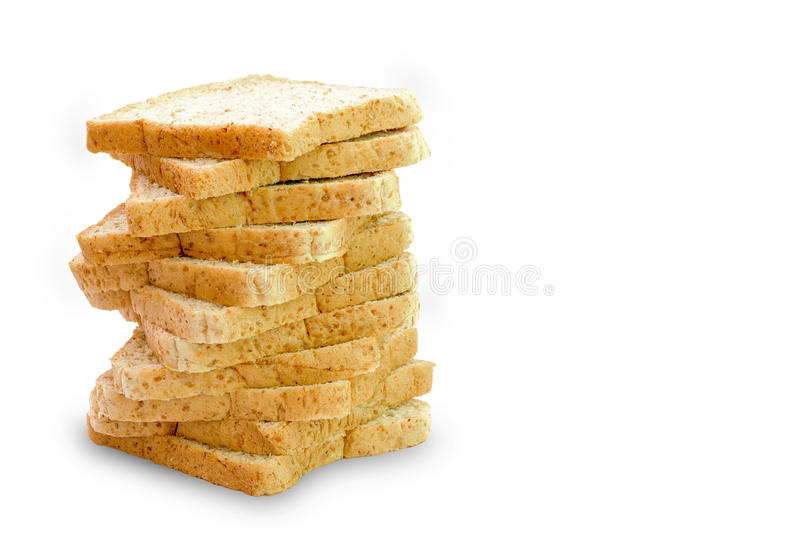 Slice of a whole wheat bread isolated. On a white background royalty free stock photos