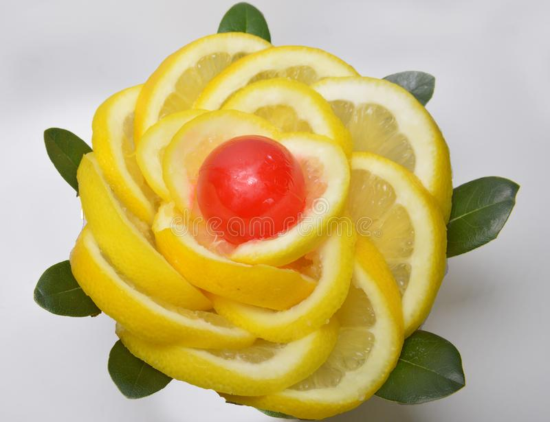 Slice yellow slices  lemon and red candy in the center royalty free stock photos