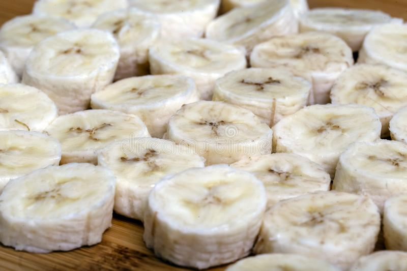 Sliced banana fruit in small pieces. Slices and pieces of banana, healthy fruit and excellent for dieting or making vitamins stock images