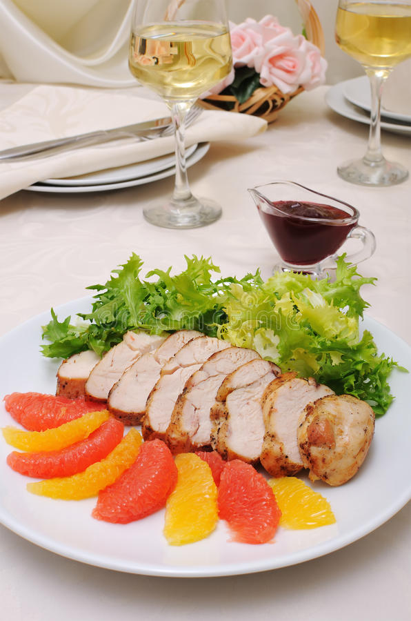 Sliced ​​baked fillet with cranberry sauce stock photo