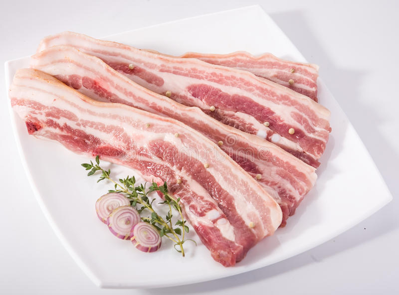Sliced meat pork. Sliced meat on white plate royalty free stock photo