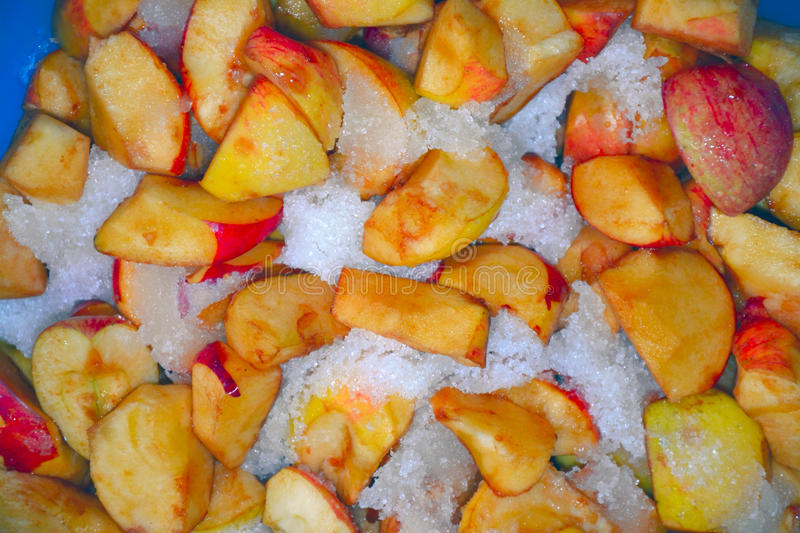 Sliced apples in the sugar closeup royalty free stock images