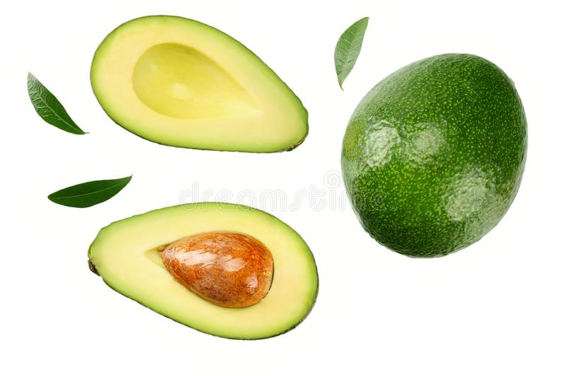 Sliced avocado with leaves isolated on white background. top view royalty free stock image