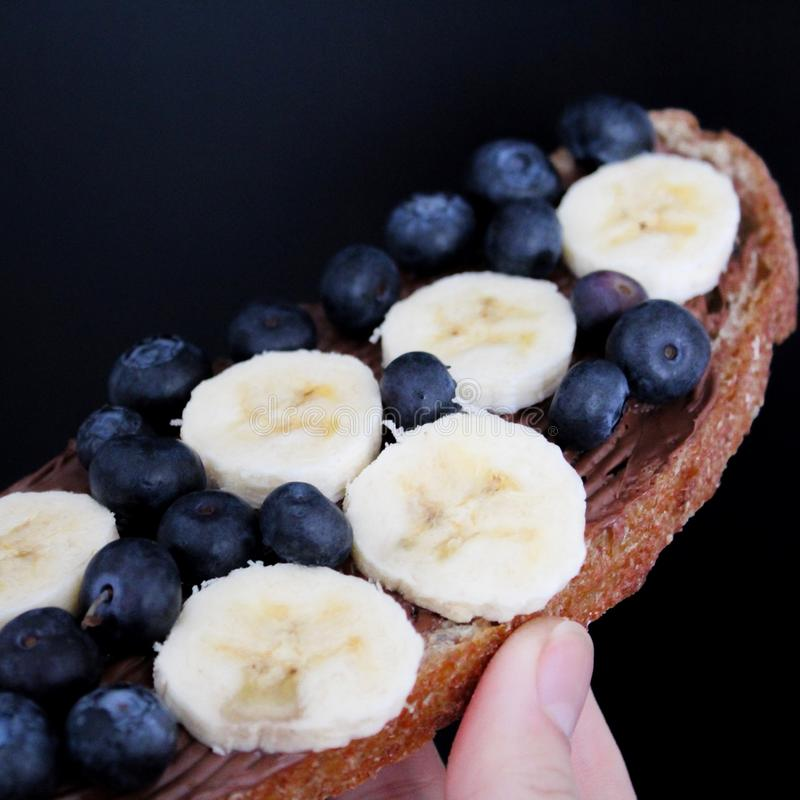 Sliced Banana With Blueberries royalty free stock image