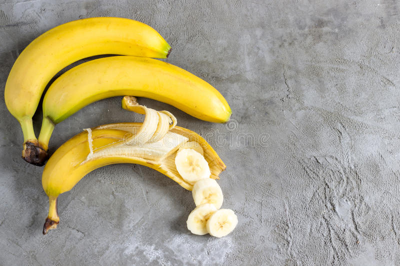 Sliced banana on concrete background royalty free stock photography