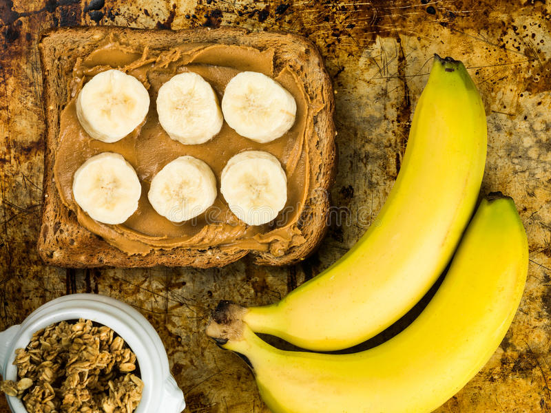 Sliced Banana and Peanut Butter on Wholegrain Toast royalty free stock photography