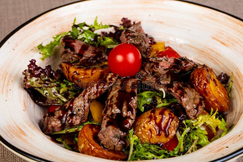 Sliced beef steak with potato royalty free stock photos