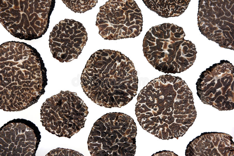 Sliced black truffes royalty free stock images