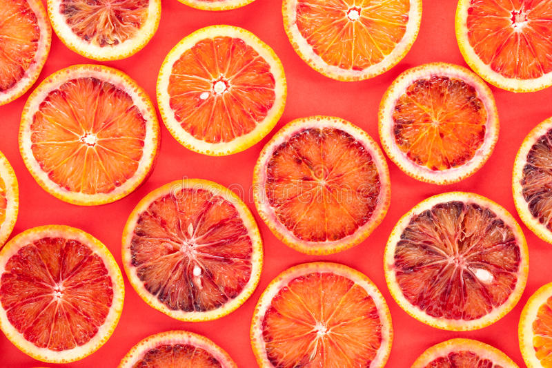 Sliced blood oranges pattern royalty free stock photo