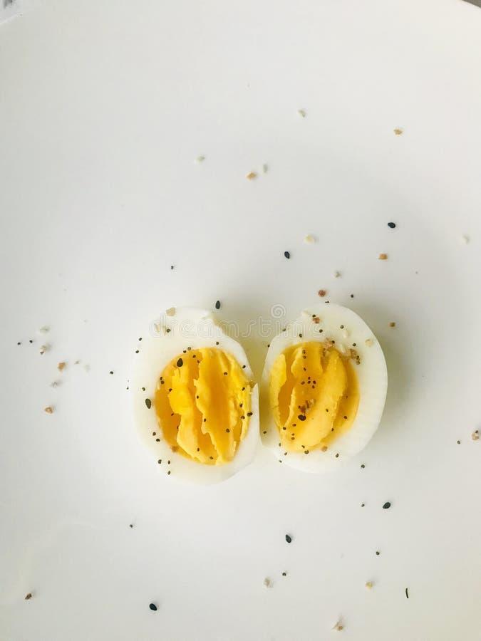 Sliced Boiled Egg on White Plate stock image