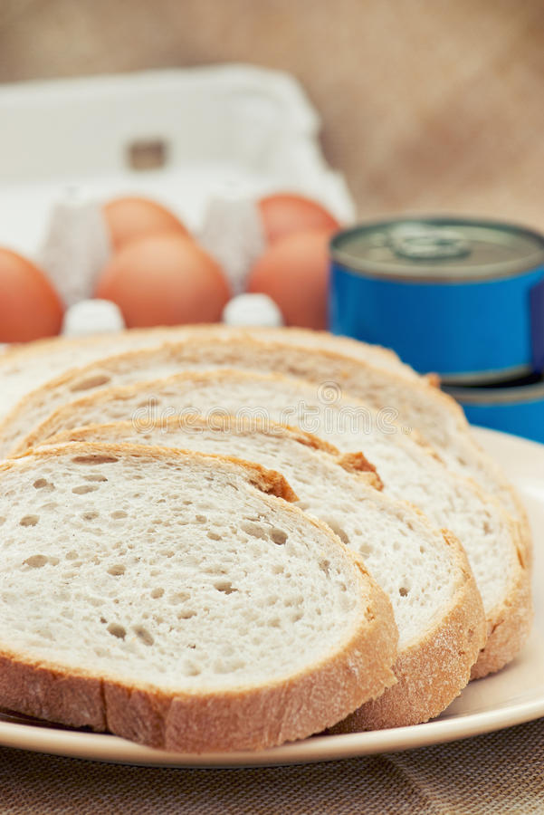 Sliced bread, canned food and eggs royalty free stock images