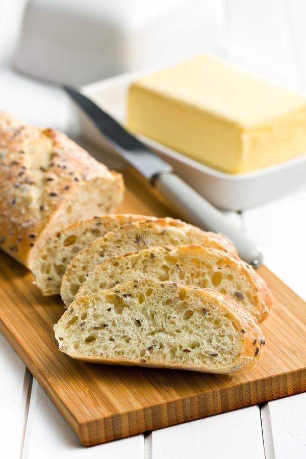 Sliced bread on cutting board stock photo