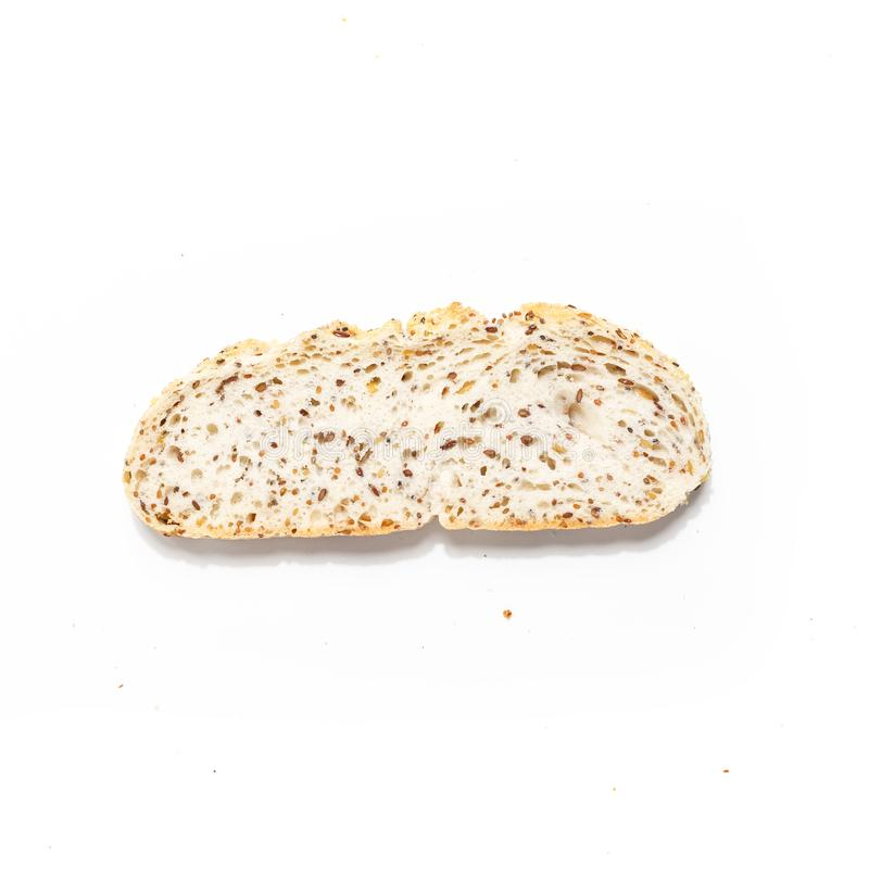 Sliced of bread, isolated on a white background. Breakfast wheat brown closeup nutrition meal food loaf fresh healthy whole texture tasty grain cereal natural royalty free stock photo