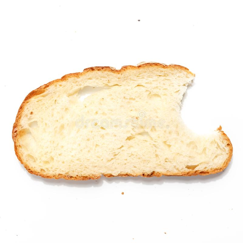 Sliced of bread, isolated on a white background. Breakfast wheat brown closeup nutrition meal food loaf fresh healthy whole texture tasty grain cereal natural royalty free stock photos
