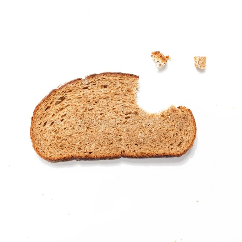 Sliced of bread, isolated on a white background. Breakfast wheat brown closeup nutrition meal food loaf fresh healthy whole texture tasty grain cereal natural royalty free stock photography