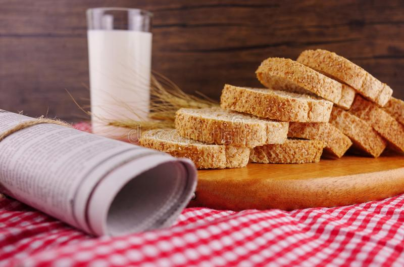 Sliced breads on wooden plate with milk royalty free stock images