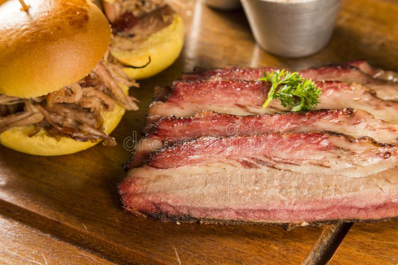 Sliced brisket with bread stock image