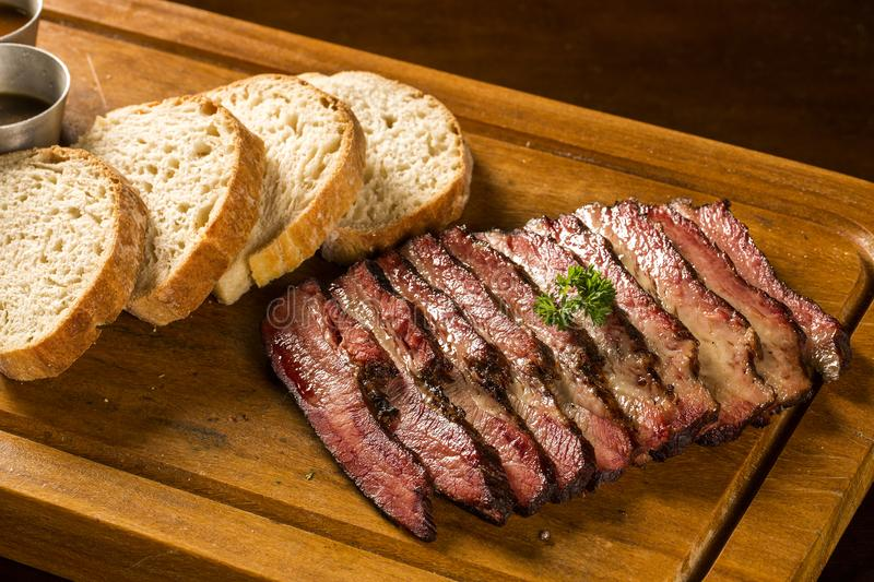 Sliced brisket with bread. Portion stock photos