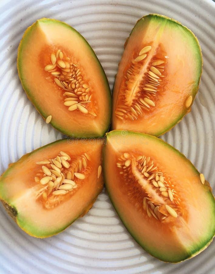 Sliced Cantaloupe Melon in Modern White Bowl stock photo