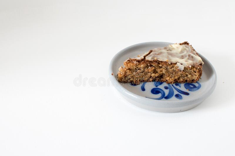 Sliced carrot cake, served on a ceramic plate. With decor stock image