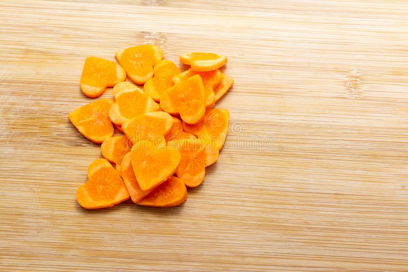 Sliced carrot on cutting board preparated for cooking stock photos