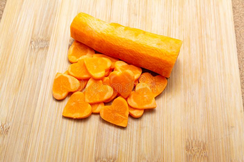 Sliced carrot on cutting board preparated for cooking stock images