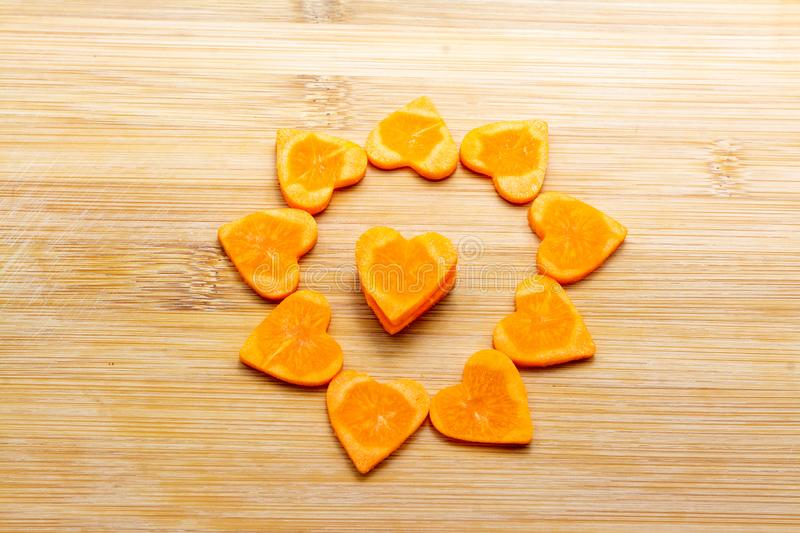 Sliced carrot on cutting board preparated for cooking royalty free stock images