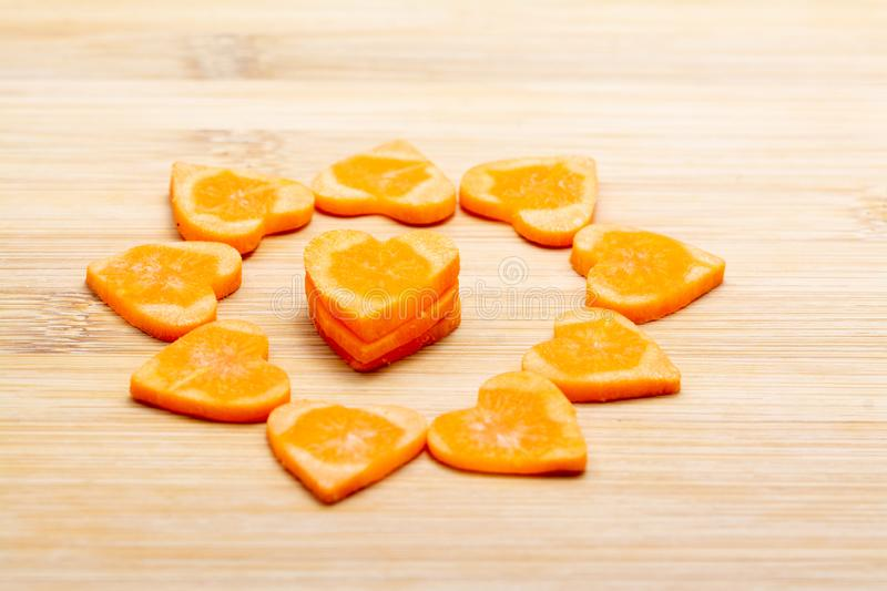 Sliced carrot on cutting board preparated for cooking royalty free stock photos