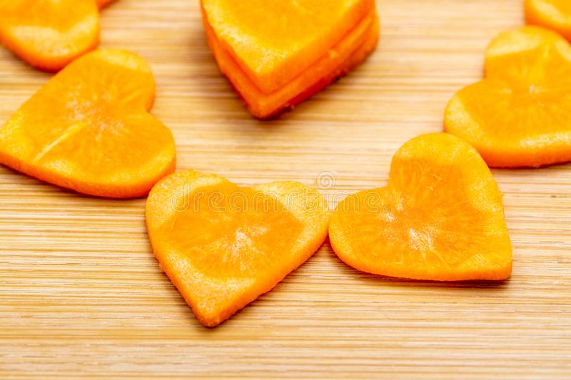 Sliced carrot on cutting board preparated for cooking royalty free stock image