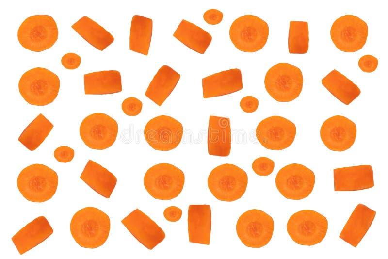Sliced carrots background. Orange pattern of fresh sliced carrots isolated on a white background. Vegetable food.  stock photos