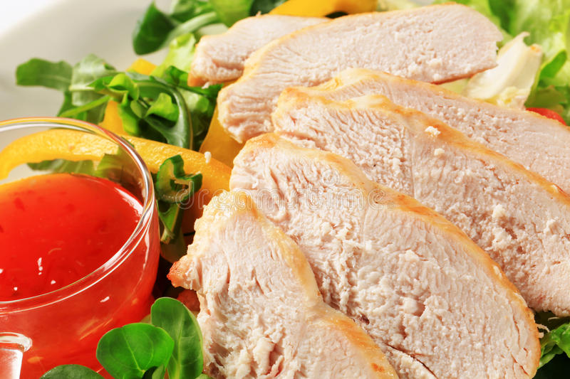 Sliced chicken breast with salad and sweet chilli sauce. Sliced chicken breast fillet with salad and sweet chilli sauce royalty free stock photography