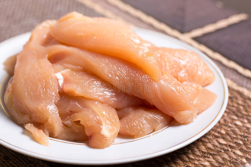 Sliced chicken white meat breasts filet on the plate stock images