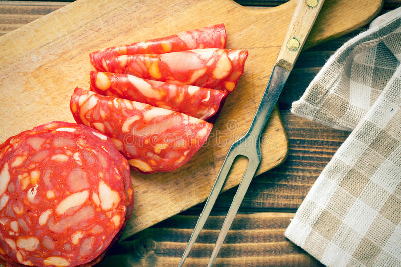 Sliced chorizo salami with fork royalty free stock photos