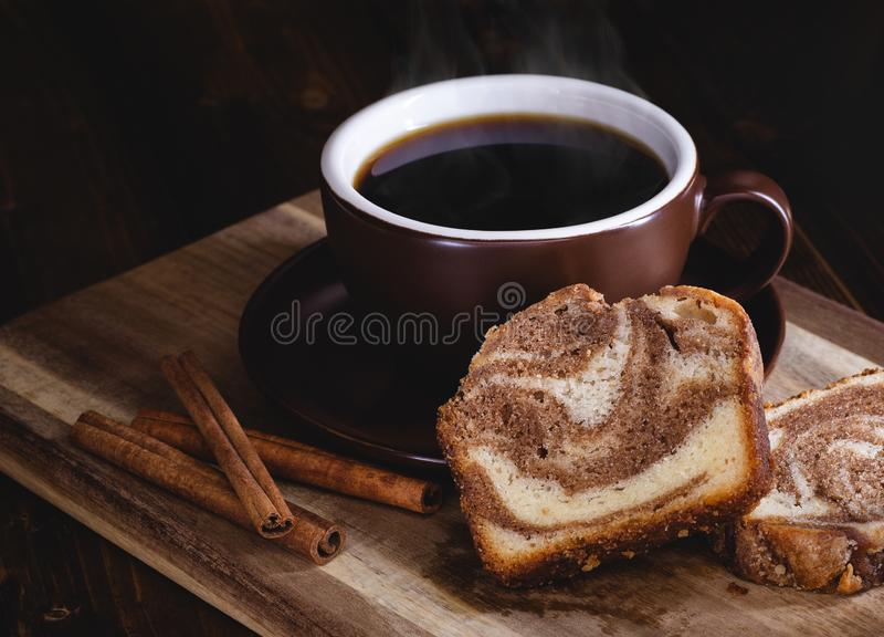 Sliced Cinnamon Swirl Sweet Bread and Cup of Coffee stock images