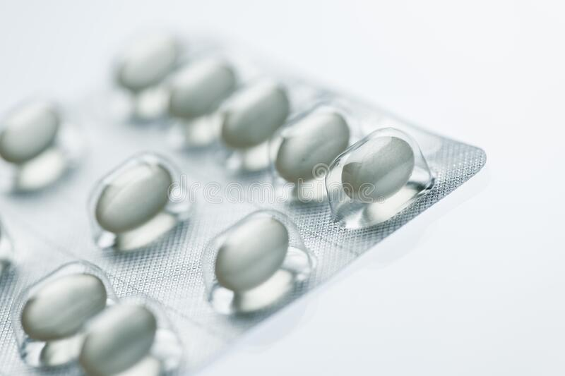 Tablets in a foil packaging on white royalty free stock image