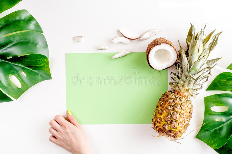 Sliced coconut and pineapple in exotic summer fruit design white background top view mock-up stock images