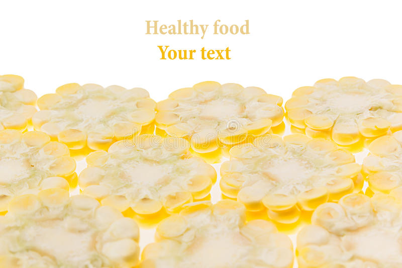 Sliced corn cobs on a white background. Isolated. Decorative frame. Macro. Food background. Copy space. Concept art stock photography