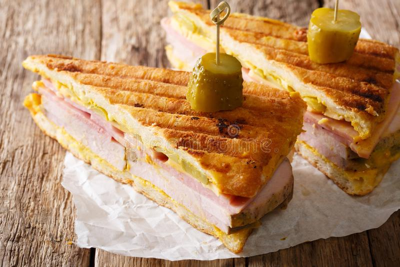 Sliced Cuban sandwich close-up on paper on a table. horizontal royalty free stock photo