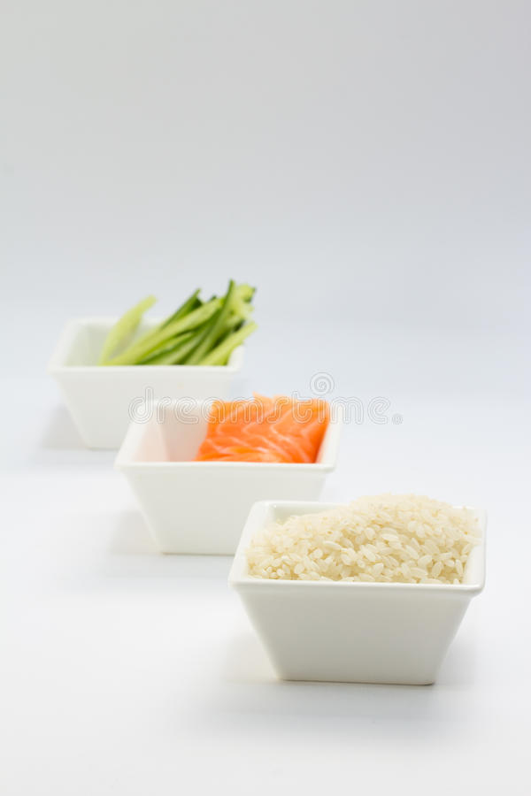 Download Sliced Cucumber Raw Salmon And Rice In White Dish Stock Photo - Image: 34466712